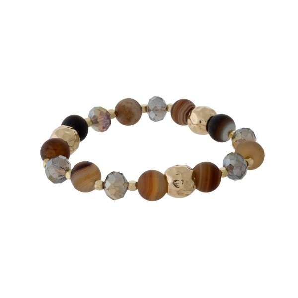 Beaded stretch bracelet with gray faceted beads, hammered gold tone beads, and brown agate natural stone beads. Handmade in the USA.