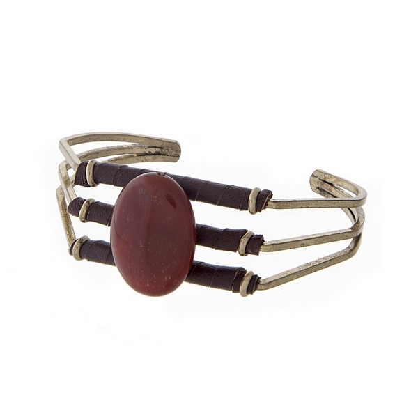 Burnished gold tone cuff bracelet with dark brown leather and a brown oval stone.