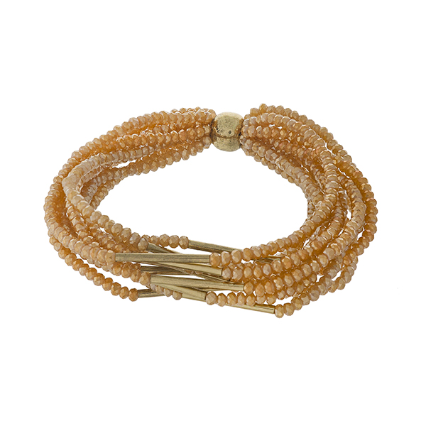 Multi strand, stretch bracelet set with topaz and gold faceted beads.