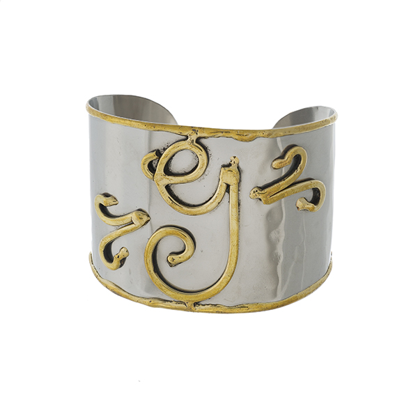 """Two tone, handmade, brass cuff bracelet with a script 'G' initial. Approximately 2"""" in width."""