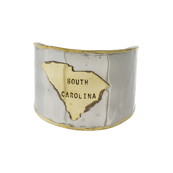 "Two tone, handmade brass cuff bracelet displaying the state of South Carolina. Approximately 2"" in width."