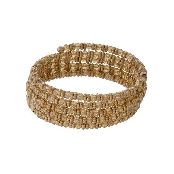 Gold tone and topaz beaded coil bracelet.