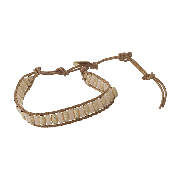 Brown cord bracelet with gold tone and ivory beads.