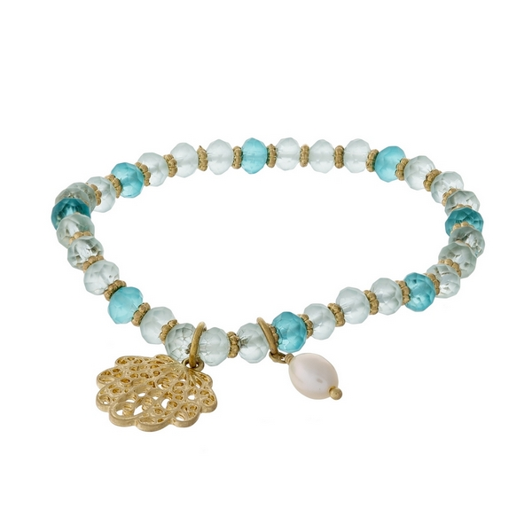 Turquoise and mint green beaded stretch bracelet featuring a gold tone seashell charm.