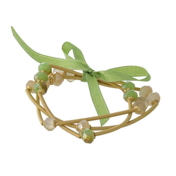 Three piece, gold tone, stretch bracelet set featuring green and ivory faceted beads.