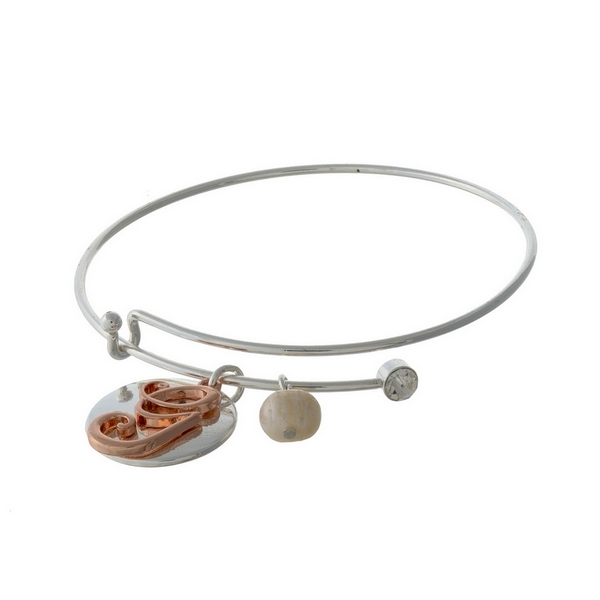 Silver tone adjustable bangle bracelet with a rose gold tone 'G' initial.