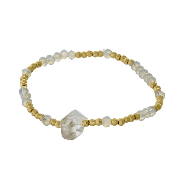 Opal and gold tone beaded stretch bracelet featuring a clear natural stone focal. Handmade in the USA.