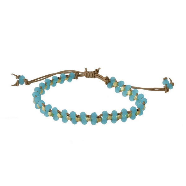 Tan cord, pull-tie bracelet featuring braided light blue faceted beads. Handmade in the USA.