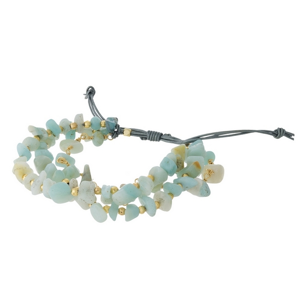 Gray cord, pull-tie bracelet featuring three rows of mint green chipstones and gold tone accents. Handmade in the USA.