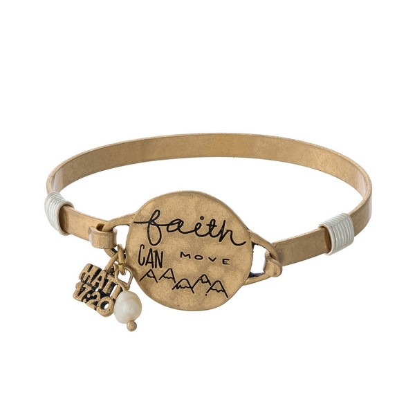 """Gold tone bangle bracelet with a circle focal stamped with """"Faith can move mountains."""""""