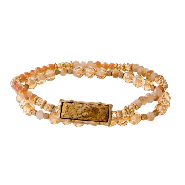 Peach, topaz, and gold tone beaded stretch bracelet set with a picture jasper stone focal.
