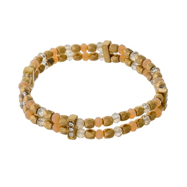 Gold tone and ivory, two row beaded stretch bracelet.