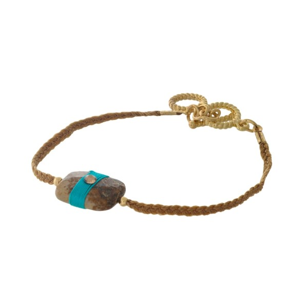 Brown braided cord toggle bracelet with a picture jasper stone focal and gold tone accents.