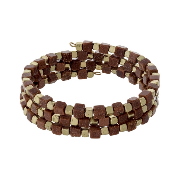 Shimmering orange square natural stone and gold tone beaded coil bracelet.