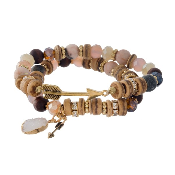 Natural stone and wooden, two piece, stretch bracelet set with an arrow focal and a faux druzy charm.