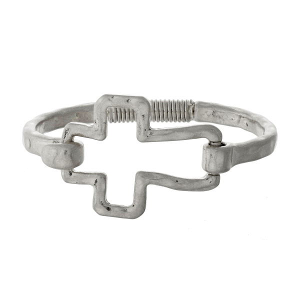 Hammered metal, hinge bracelet with an open cross focal.