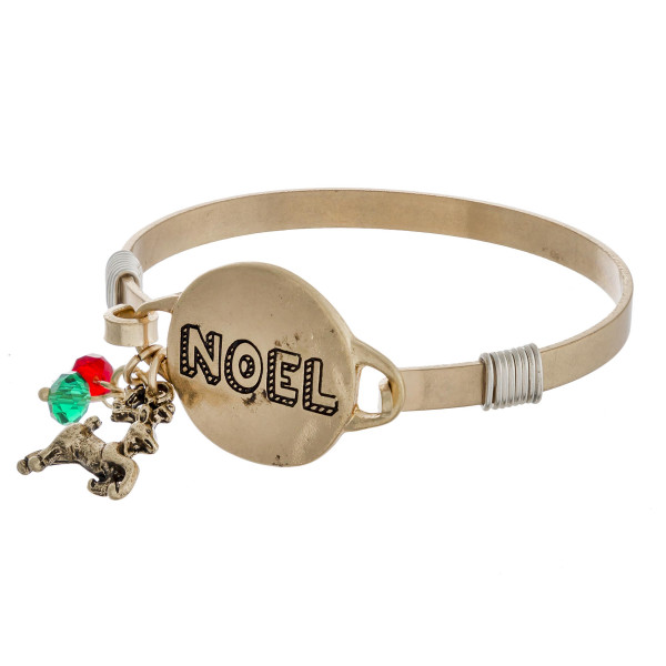 "Noel engraved gold Christmas bangle charm bracelet with wire wrapped details and hook closure. Approximately 2.5"" in diameter. Fits up to a 5"" wrist."