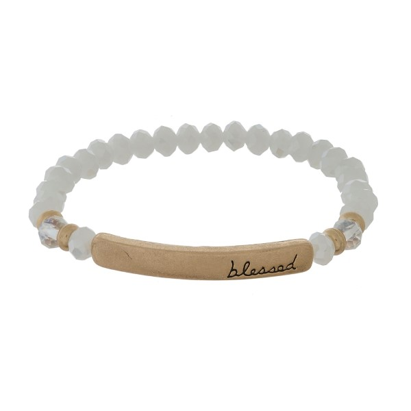 "Beaded stretch bracelet with a bar focal, stamped with ""blessed."""
