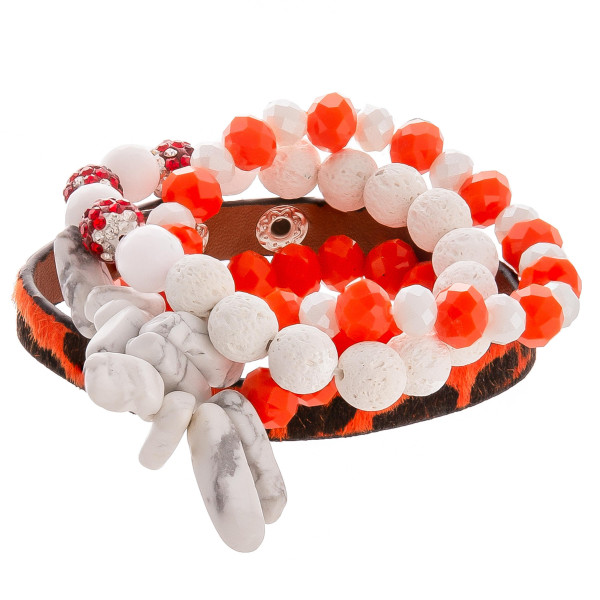 """Gorgeous natural stone and bead bracelet with leather animal print snap bracelet. Approximate 3"""" in diameter."""