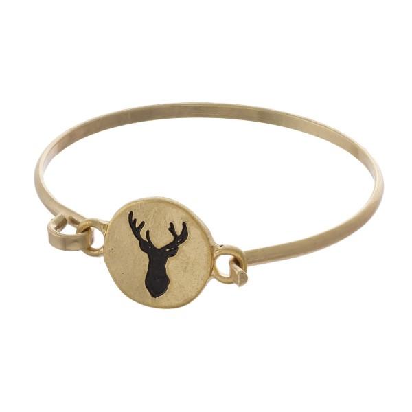 Metal bracelet stamped with deer head shape.