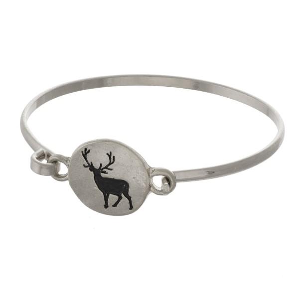 Metal bracelet with a deer stamped focal.