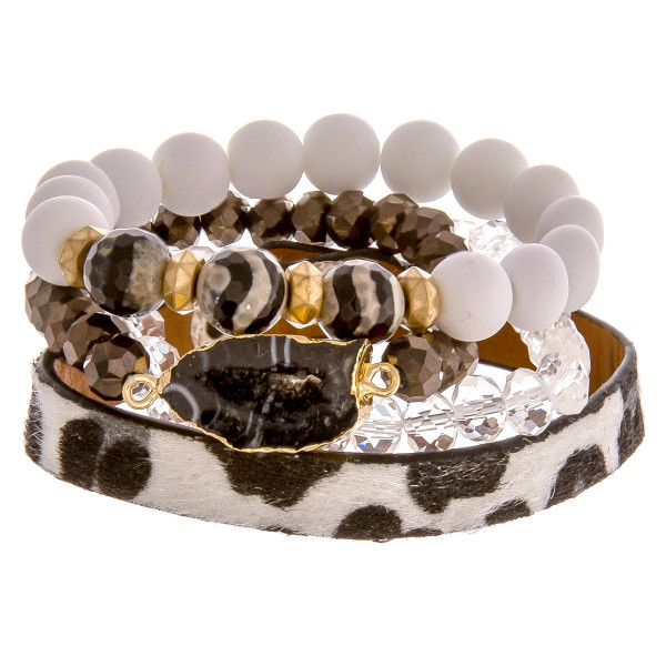 """Set of 4 bracelets featuring 3 beaded stretch bracelets and an adjustable animal print band. Approximately 2.5"""" in diameter unstretched. Fits up to a 6"""" wrist."""