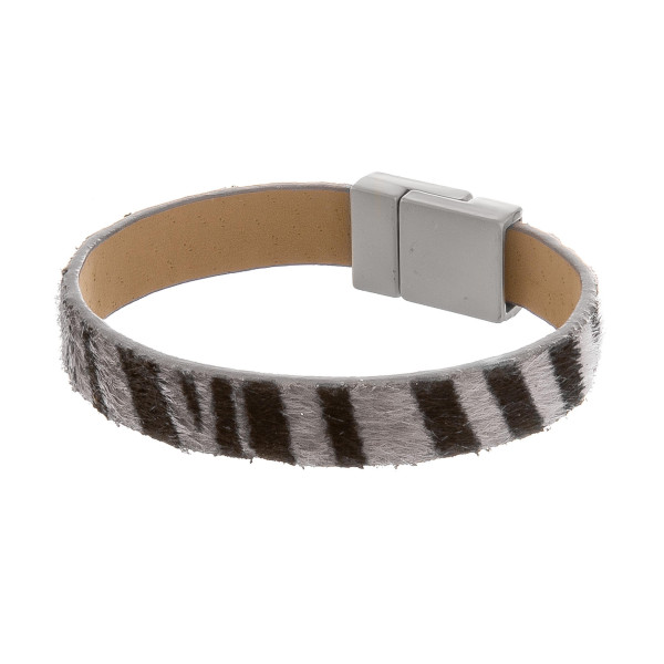 "Magnetic animal print leather bracelet. Approximate 8"" in length."