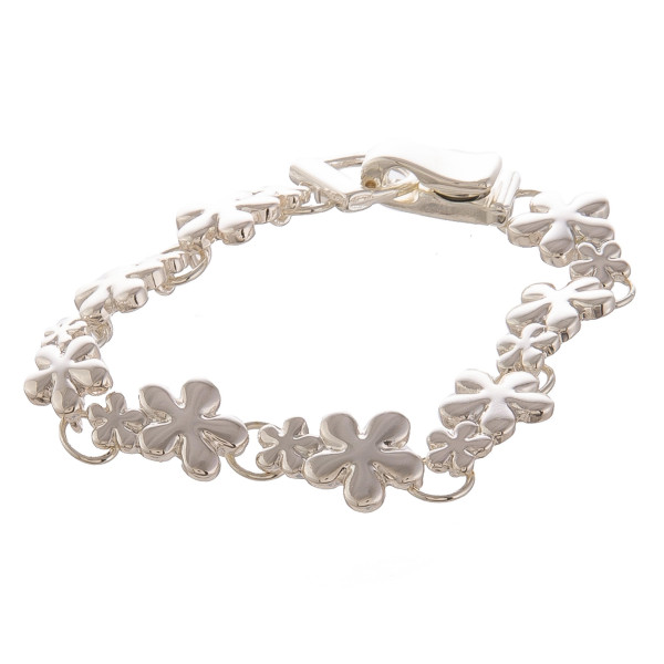 """Metal bracelet with flowers. Approximate 6"""" in length."""