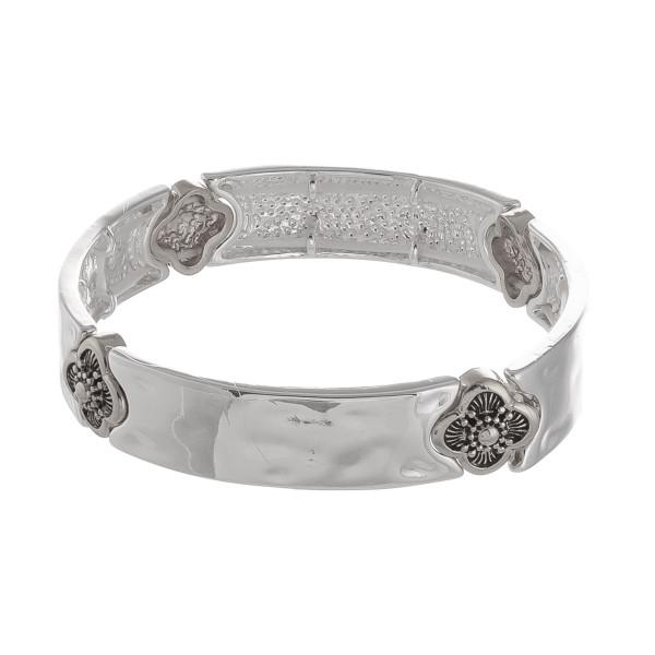 "Metal bracelet with engraved metal design details. Approximate 6"" in length."