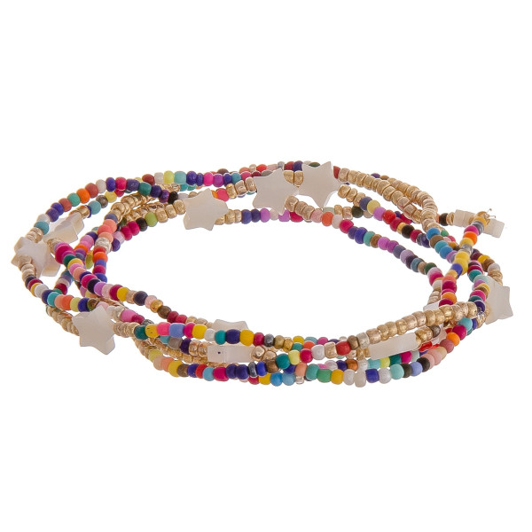 "Set of five stretch bracelet featuring multicolor and gold beads with star details. Approximately 2.5"" in diameter unstretched. Fits up to 5"" wrist."