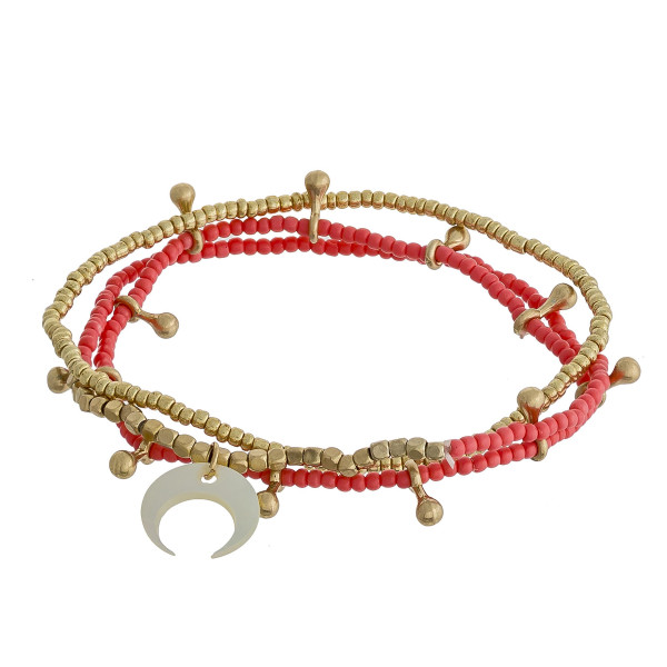 """Bracelet set featuring three beaded stretch bracelets with gold accents and a crescent detail. Approximately 2"""" in diameter unstretched. Fits up to a 5"""" wrist."""