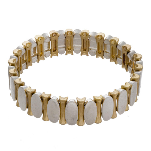 """Two tone metal oval-bar stretch bracelet. Approximately 3"""" in diameter unstretched. Fits up to a 6"""" wrist."""