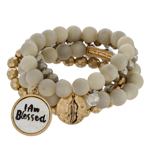 "Natural stone and bead stretch bracelet with I am blessed message. Approximate 6"" in length."