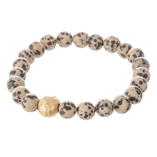 """Dalmatian inspired beaded stretch bracelet with a gold accent. Approximately 3"""" in diameter unstretched. Fits up to a 6"""" wrist."""