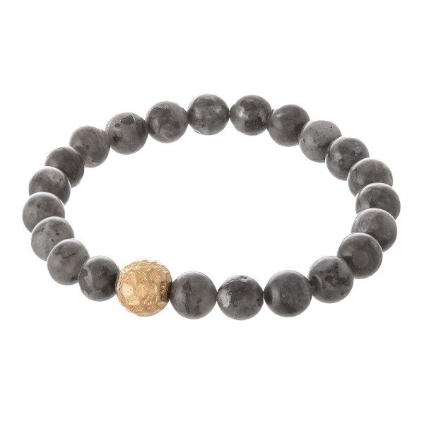 """Dark grey beaded stretch bracelet with a gold accent. Approximately 3"""" in diameter unstretched. Fits up to a 6"""" wrist."""