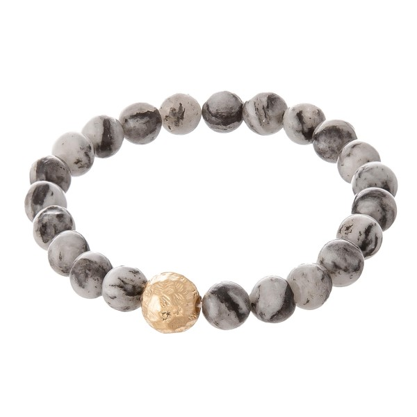 """Natural stone stretch beaded bracelet with gold bead wrist details. Approximate 8"""" in length."""