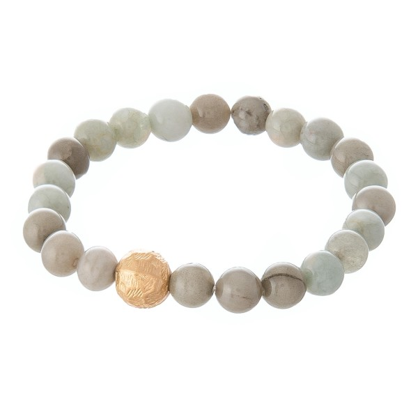 """Light mint beaded stretch bracelet with a gold accent. Approximately 3"""" in diameter unstretched. Fits up to a 6"""" wrist."""