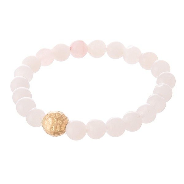 """Pink beaded stretch bracelet with a gold accent. Approximately 3"""" in diameter unstretched. Fits up to a 6"""" wrist."""