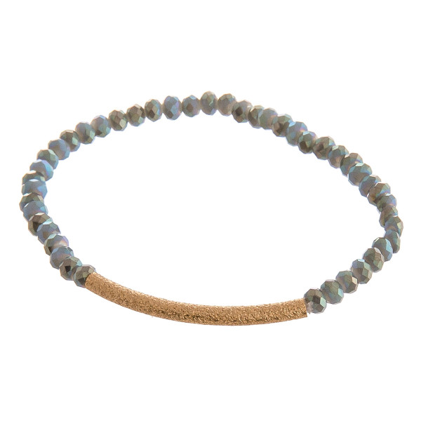 "Iridescent beaded stretch bracelet featuring a gold focal accent. Approximately 3"" in diameter unstretched. Fits up to a 6"" wrist."