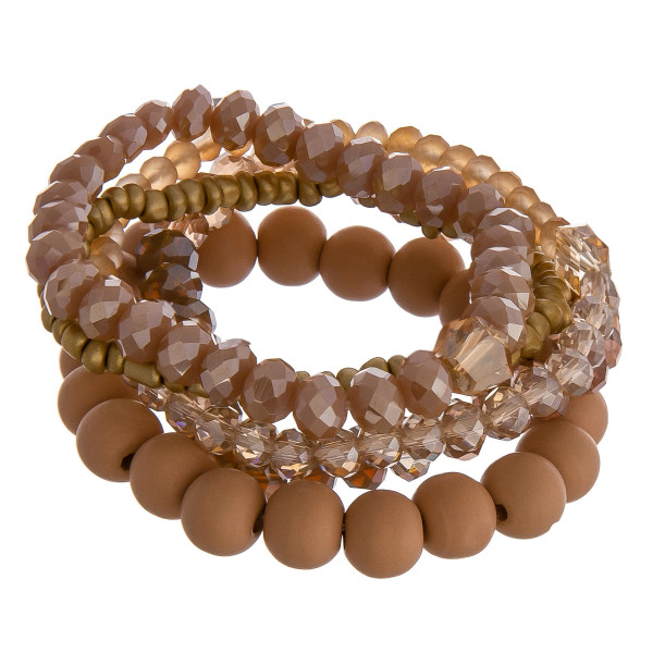 """Set of five beaded stretch bracelets featuring wood beads and gold accents. Approximately 2.5"""" in diameter unstretched. Fits up to a 5"""" wrist."""