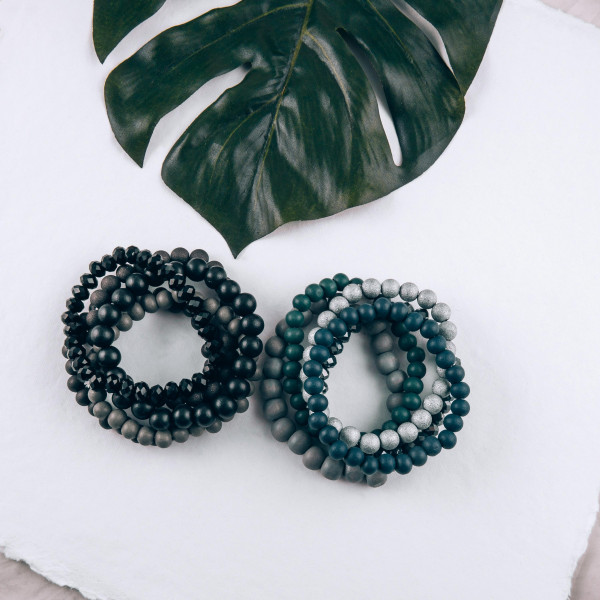 """Wood Beaded Stackable Stretch Bracelet Set Featuring Acrylic & Faceted Beads.  - 5pcs per set - Approximately 3"""" in diameter - Fits up to a 7"""" wrist"""