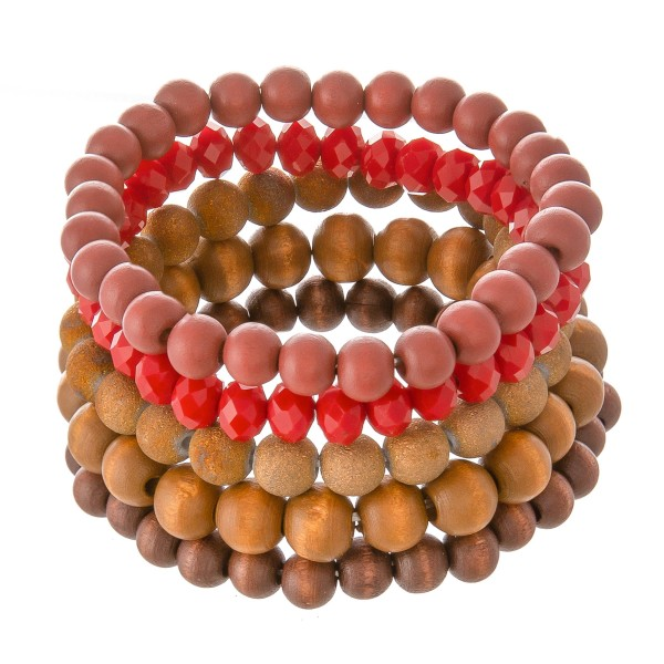 """Bracelet set featuring three wood beaded bracelets with one faceted acrylic beaded strand and one ceramic glitter beaded strand. Approximately 2.5"""" in diameter unstretched. Fits up to a 5"""" wrist."""
