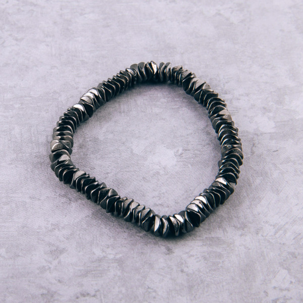 """Hematite stretch bracelet featuring metal bead accents. Approximately 3"""" in diameter unstretched. Fits up to a 6"""" wrist."""