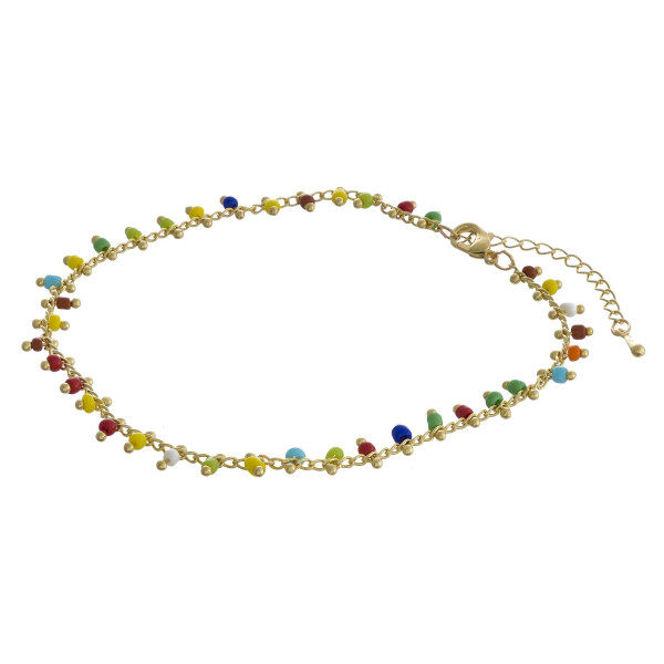 """Beaded anklet featuring plastic bead details with gold accents. Approximately 4"""" in diameter. Fits up to 8"""" ankle."""