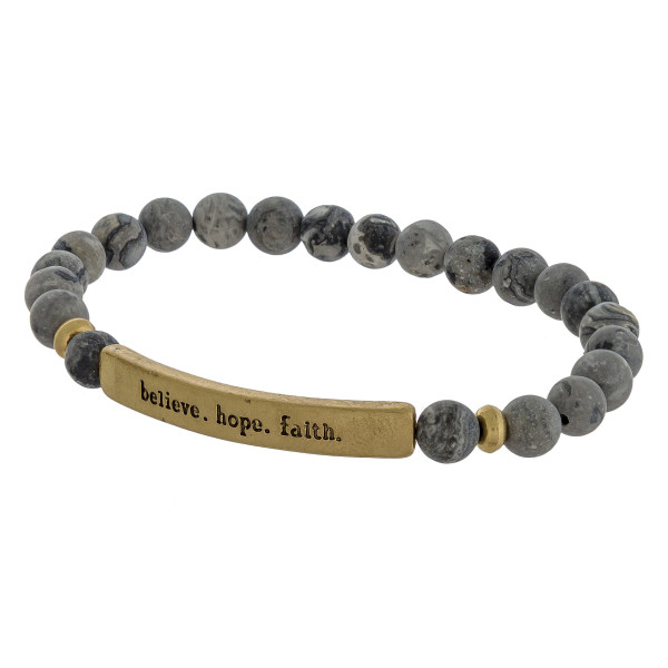 "Beaded stretch bracelet featuring a metal accent engraved with ""believe. hope. faith."" Approximately 3"" in diameter unstretched. Fits up to a 6"" wrist."