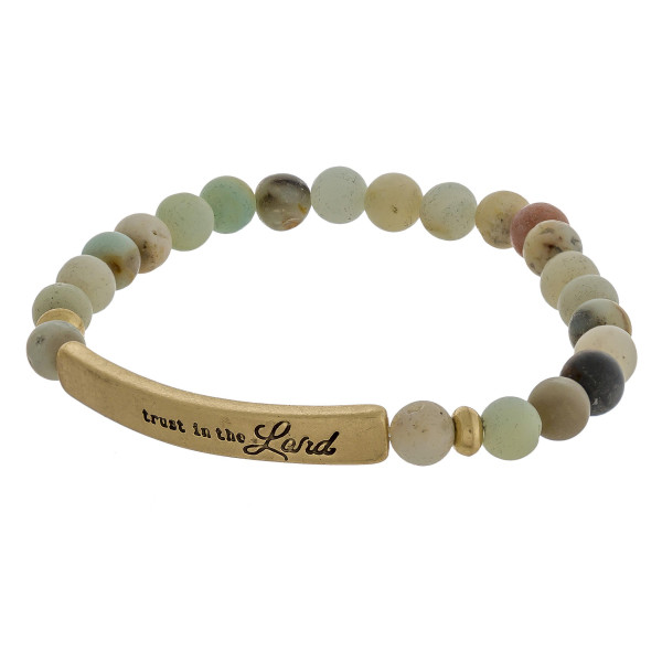 "Beaded stretch bracelets featuring a metal accent engraved with the phrase ""Trust in the Lord""."