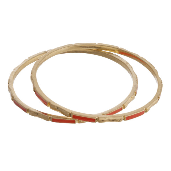 """Metal bangle bracelet featuring coral and gold accents. Approximately 2.75"""" in diameter. Fits up to a 5.5"""" wrist."""