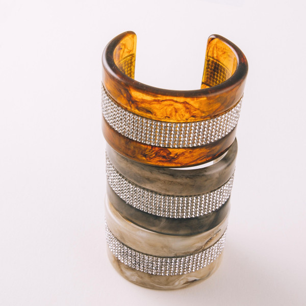 """Resin inspired cuff bracelet featuring rhinestone details. Approximately 2.5"""" in diameter. Fits up to a 5"""" wrist."""