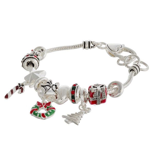 """Christmas charm bracelet with lobster clasp. Approximately 3"""" in diameter. Fits up to a 6"""" wrist."""