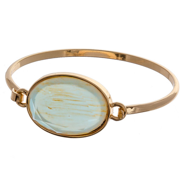 """Metal bangle bracelet featuring a iridescent acrylic focal. Approximately 3"""" in diameter. Fits up to a 6"""" wrist."""